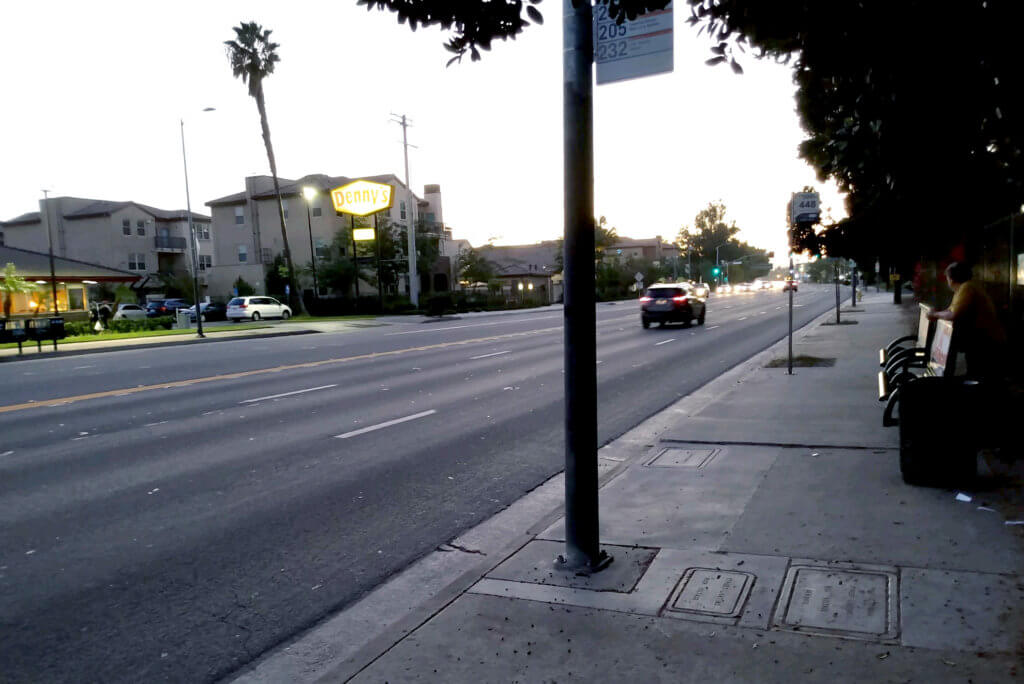 View of road, Dennys and bus stop in California