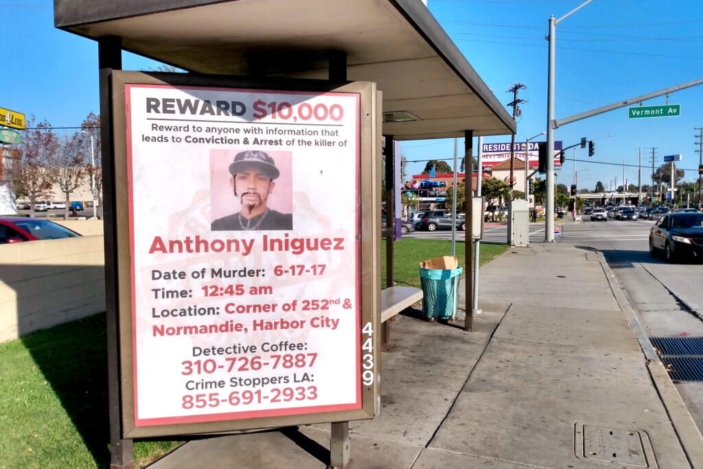The poster that reward for criminal murder at bus stop