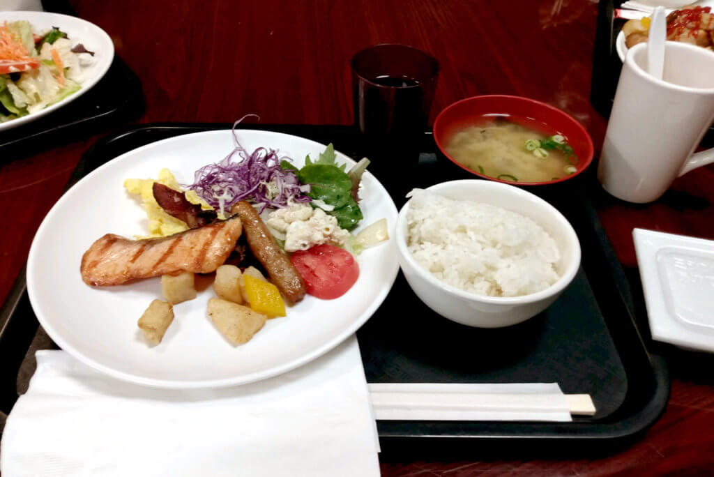 Japanese Breakfast these are Miso soup, rice and a grilled salmon