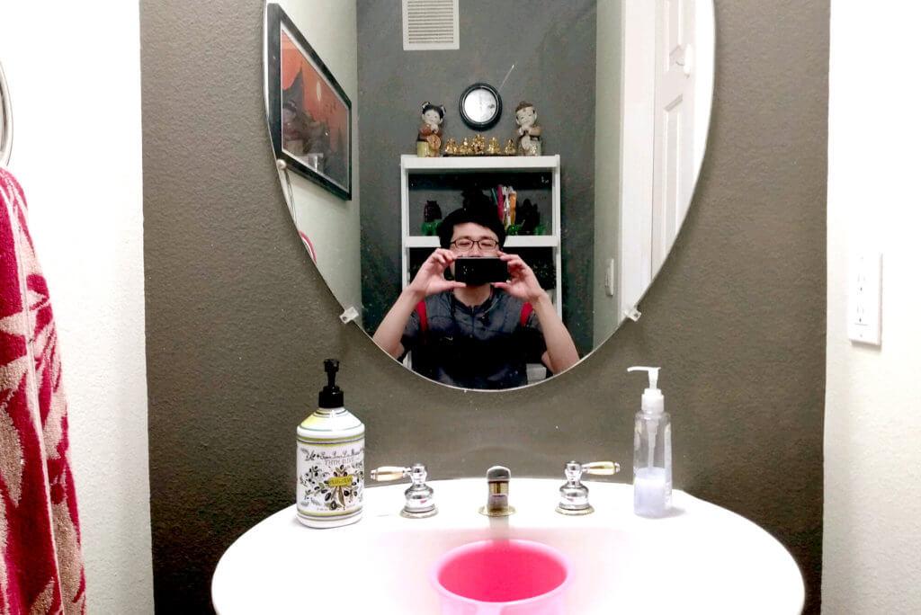Artist's self portrait in restroom