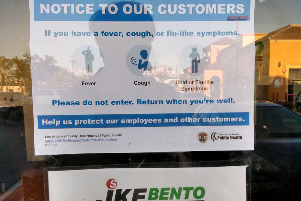 Caution of coronavirus poster at restaurant in the US