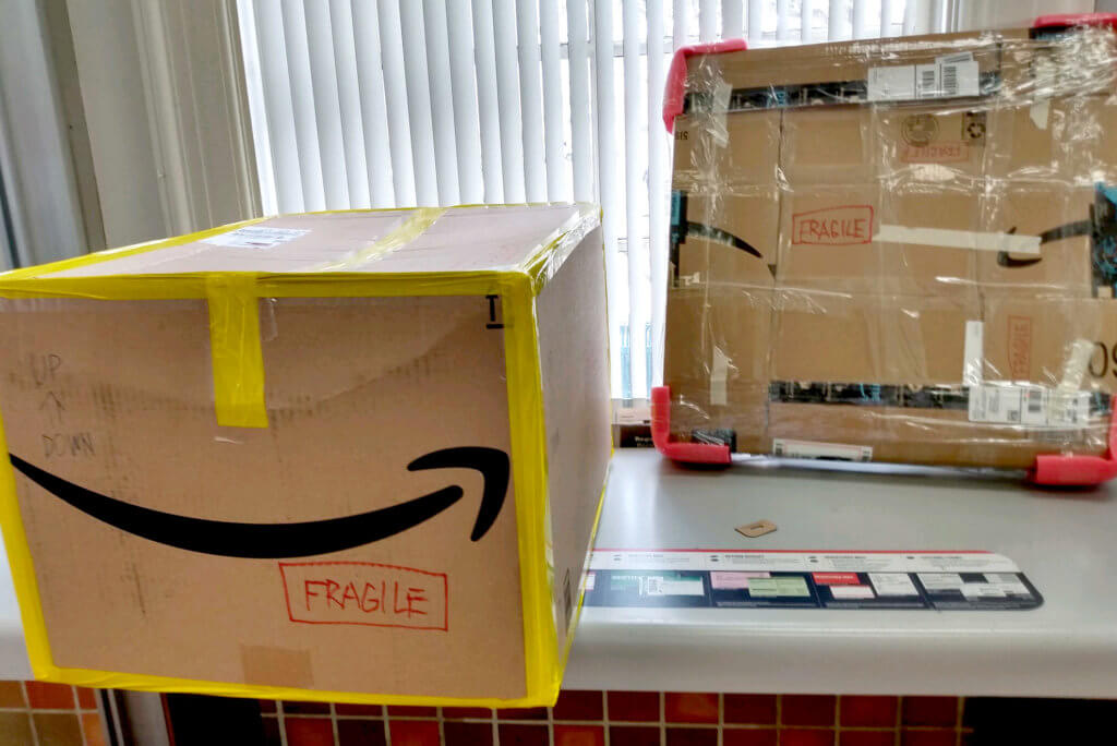 Paintings in amazon packages at the USPS in LA
