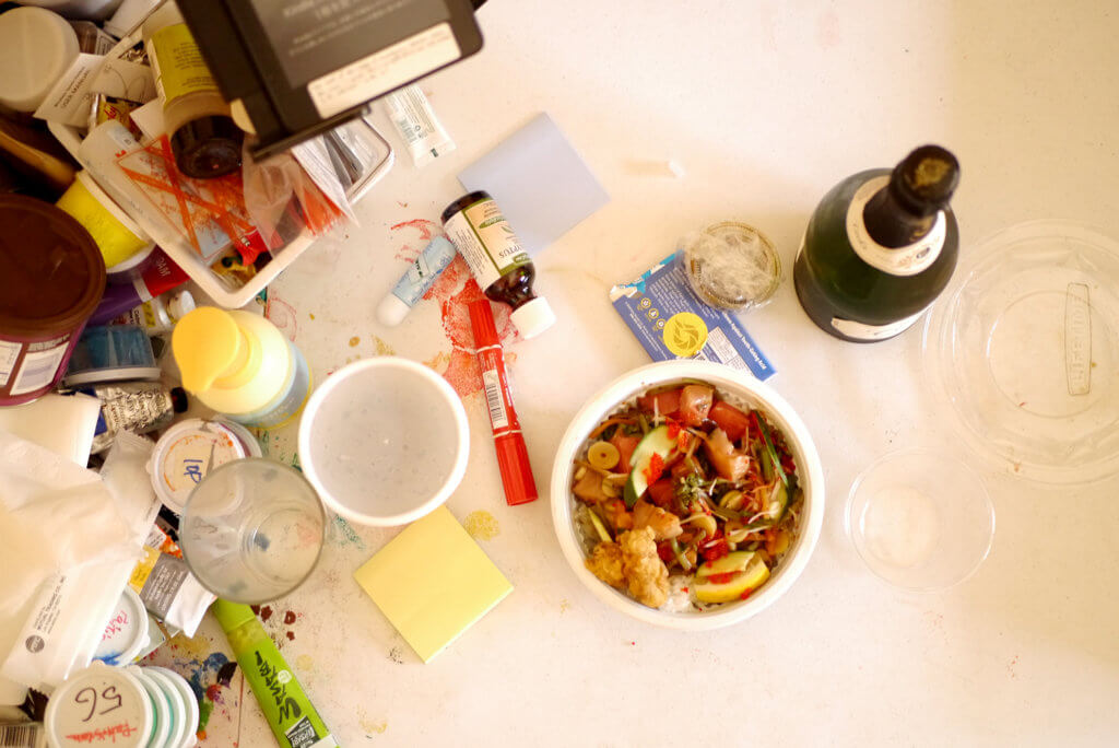 Poke bowl and champagne on the table