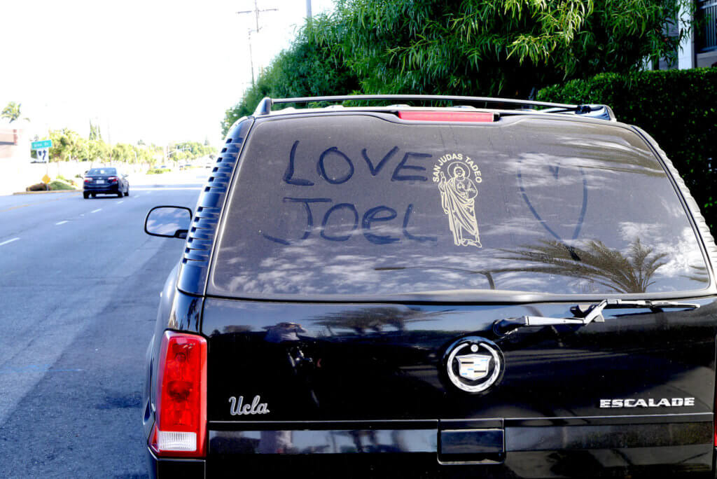 Finger drawing that love joel on the car windows