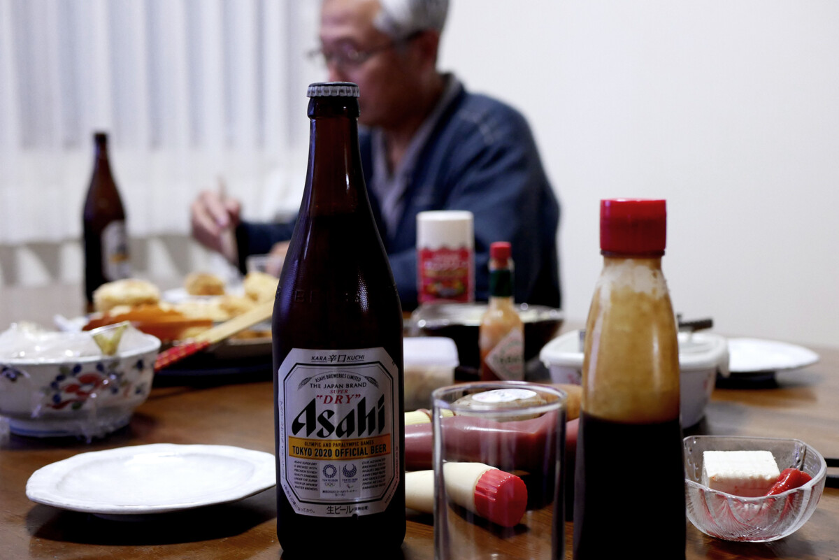 Asahi beer on the table on the table and behind is my father