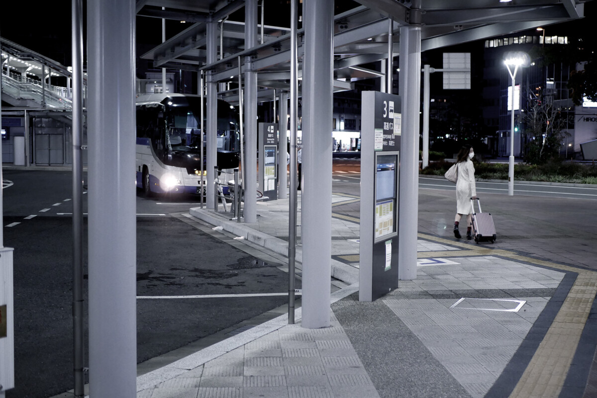 An woman is going to take an express bus at the bus station in Hiroshima Japan