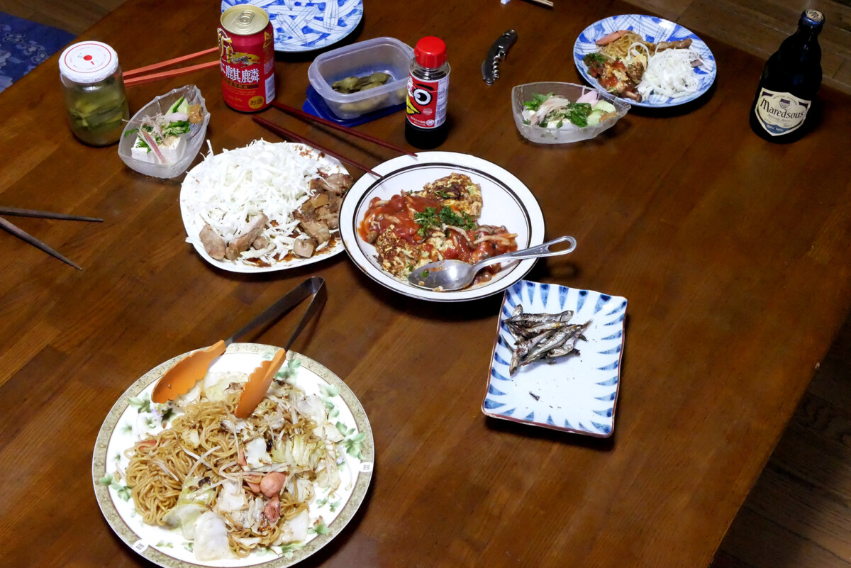 Fried noodles, Natto omllet, and dried sardines etc on the table in Hiroshima Japan