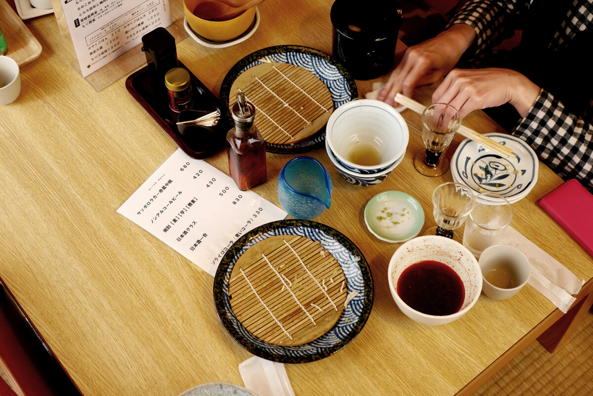 Table after eating Japanese soba (Nihachi-jyuroku) with women's hands