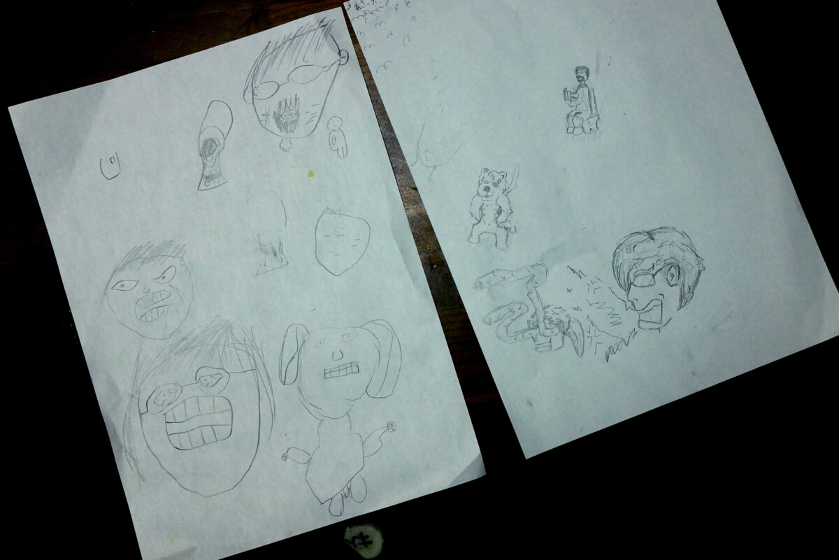 Japanese elementary school kid's drawings on the white paper