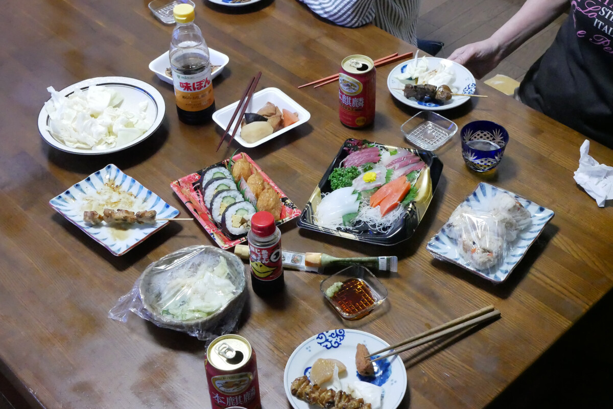 Packed meals like roll sushi, sashimi, yakitori and just cutting cabbage on the table in Hiroshima Japan