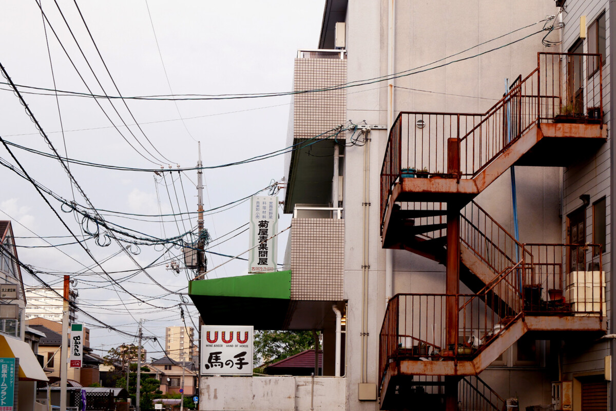 Electrical wire and an old iron stairs in a small town in Hiroshima Japan