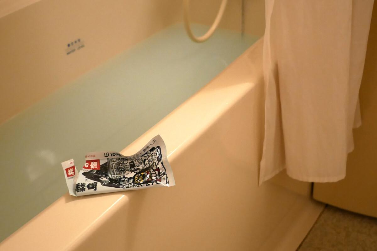 A bathtub with white hot water containing bath salts at Sotetsu grand fressa in Hiroshima Japan