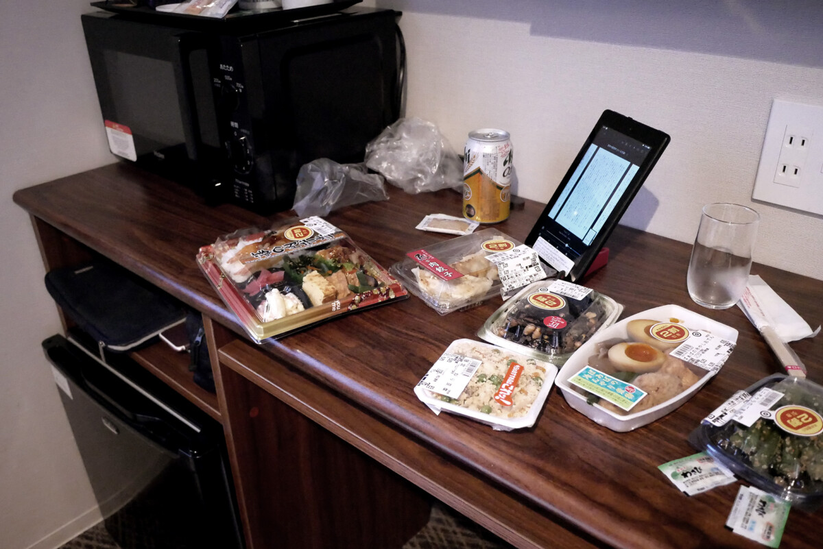 bento and pre cooked meal on the table at Livemax hotel room in Hiroshima Japan