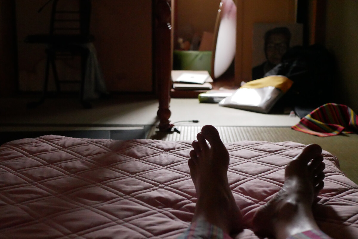 Man's Feet on the futon bed in the early morning lights in Hiroshima Japan