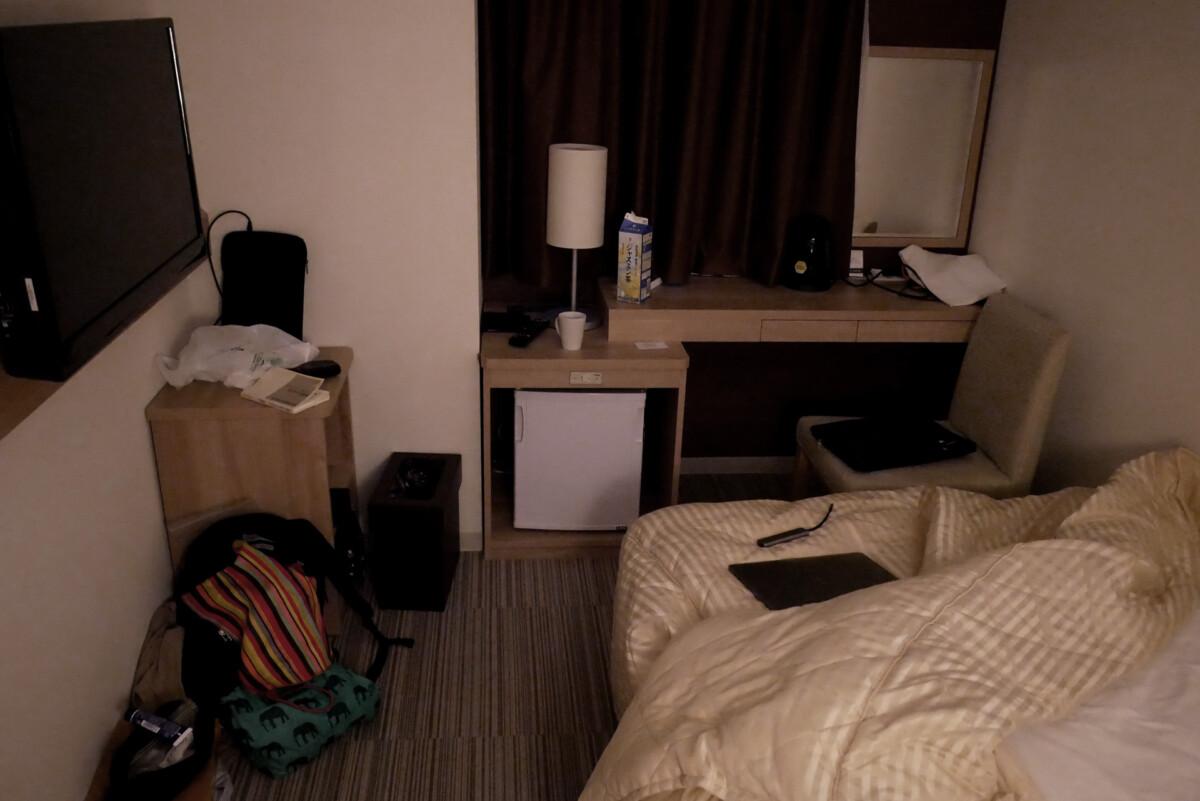 Still dark in the early morning at Koko hotel's single room in Hiroshima Japan