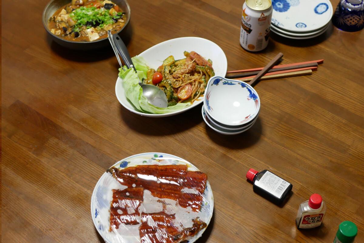 Mapo eggplant, stirred goya and grilled unagi on the table in Hiroshima Japan