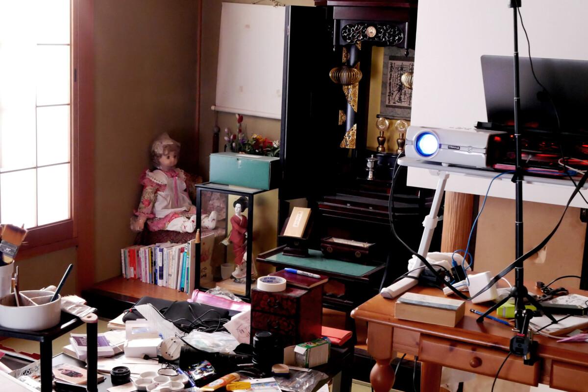 a doll, projector, laptop etc. quite messy Japanese washitsu tatami mat room in Hiroshima Japan