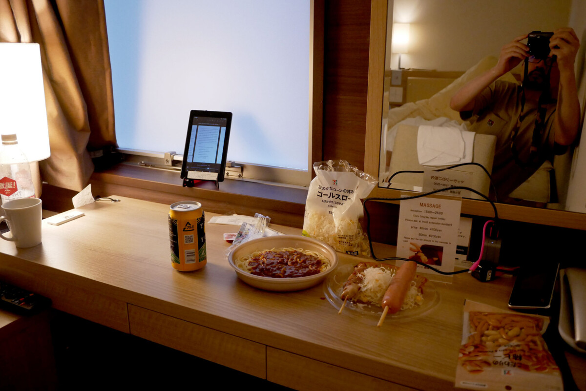 Pre cooked meal and canned beer on the table at KOKO hotel's room in Hiroshima Japan