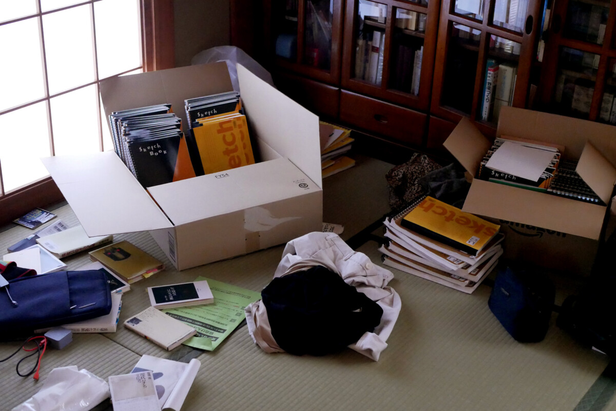 Sketch books in the cardboard boxes on the tatami mat floor in Hiroshima Japan