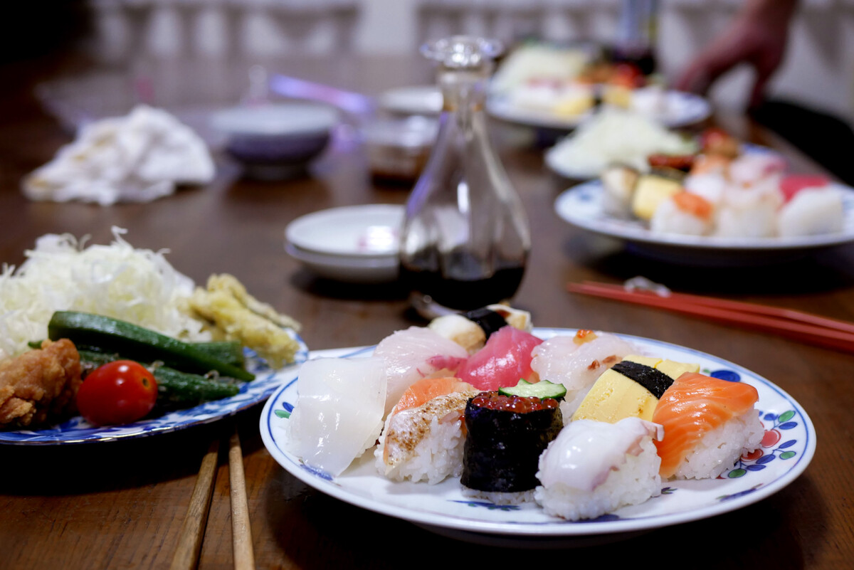 10 variety of Sushi and salad plate on the table at Japanese family's house