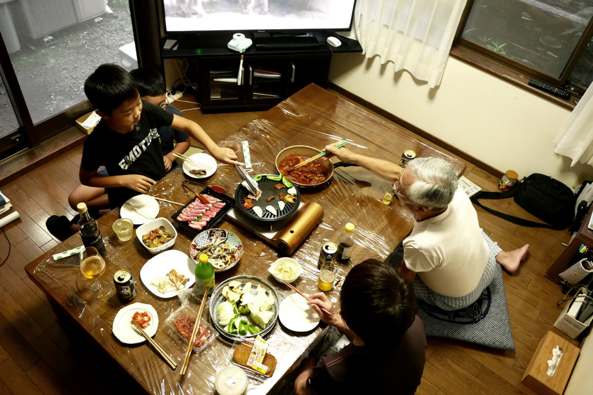 Boys and elder people eating BBQ at Japanese house in Hiroshima Japan
