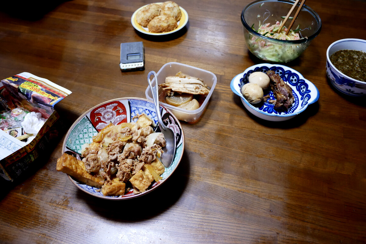 Japanese nimono, simmered pork rib and dishes on the wooden table in Hiroshima Japan