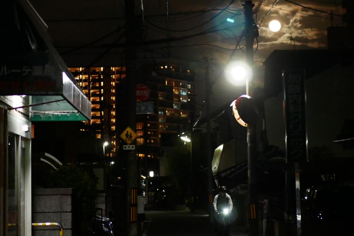 Full moon in the sky above the dark road in Hiroshima Japan
