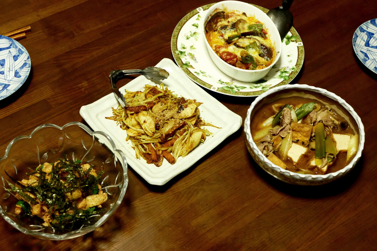 Four plate of the home made Japanese dishes on the wooden table