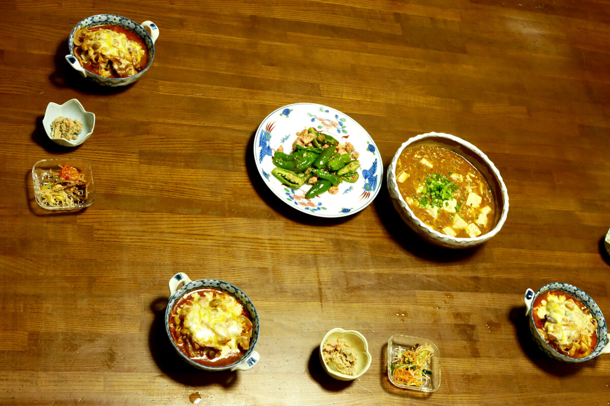 Japanese daily dishes like mapo-tofu kobachi and tomato soup on the table