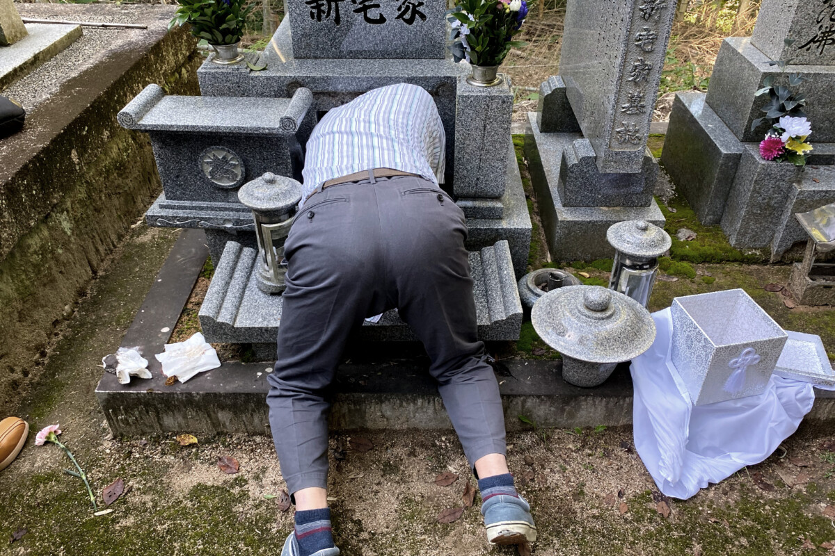 An old Japanese man is going to into an ancient tomb