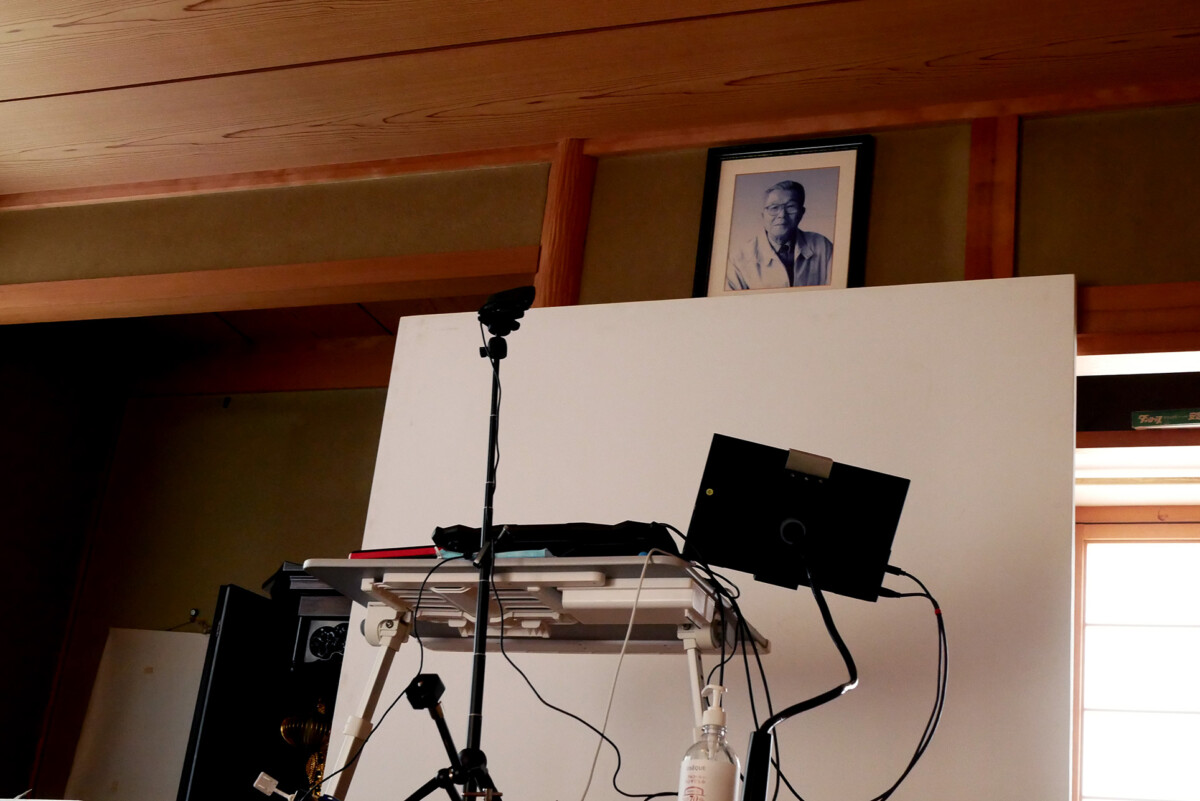 A portrait of deceased person above the web designer's working desk