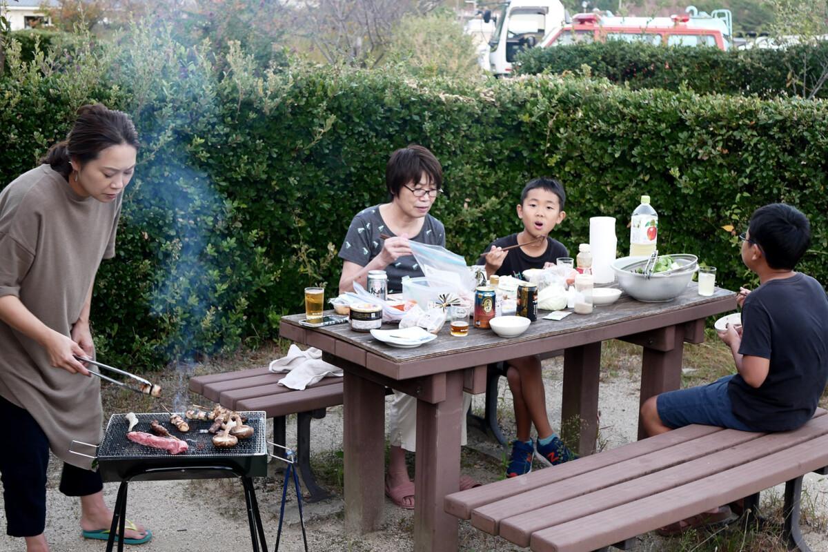 A family are having BBQ at outside in Hiroshima Kamagari island Japan