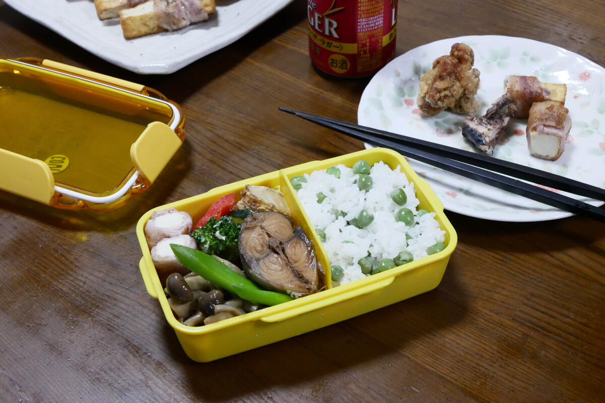 Home made Bento and plates on the wooden table