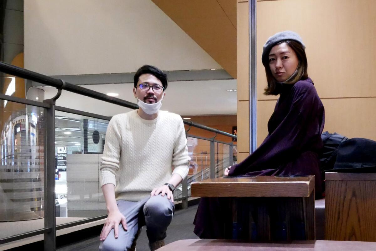 Man and woman selfee at the Narita international airport