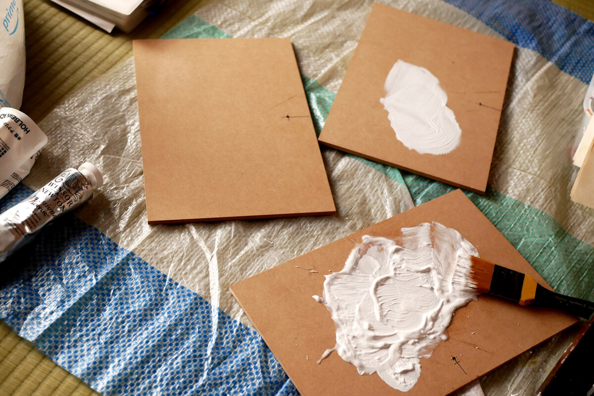 Painted white three MDF boards on the plastic sheet