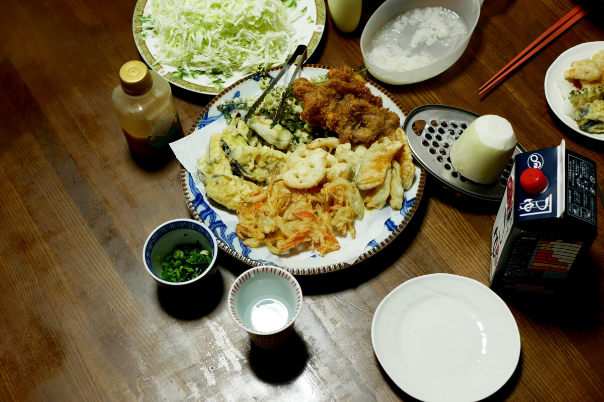Variety of Tempura on the plate, shredded cabbage ion the wooden table