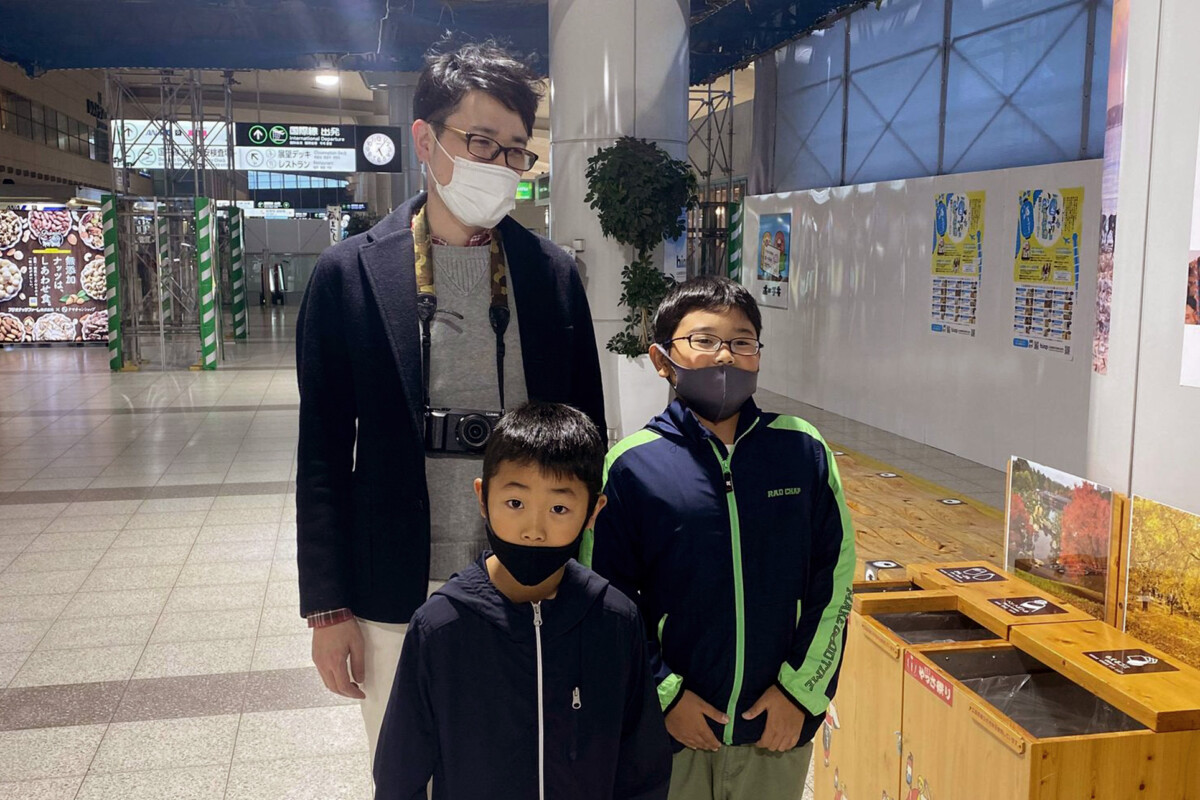 Uncle with nephews at the Hiroshima airport
